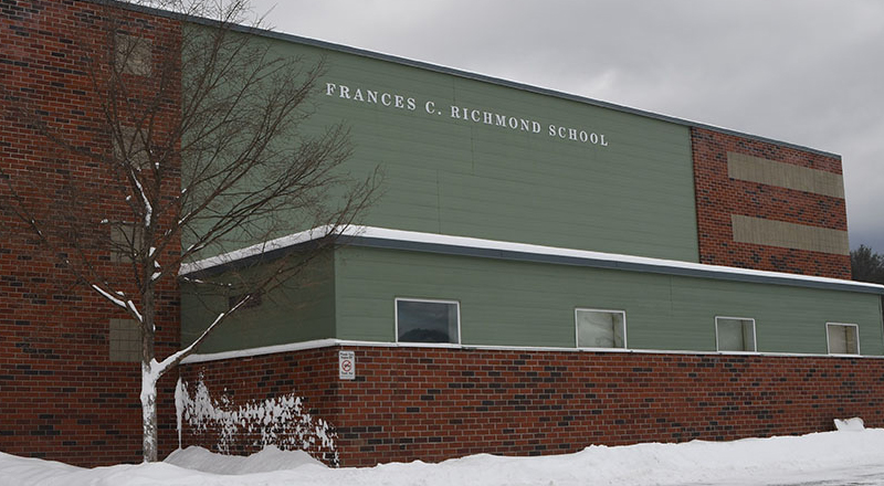 Francis Richmond School building from front with snow on the ground